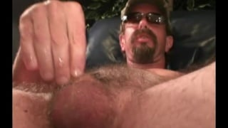 bearded redneck strokes off in his sunglasses