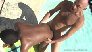 hot daddy fucks a black lad outside by the pool