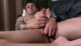 inked muscle stud strokes his thick uncut cock