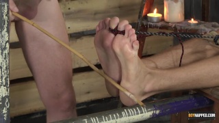 bound lad gets his feet caned