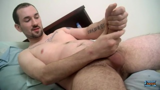 two handed stroker works his huge cock