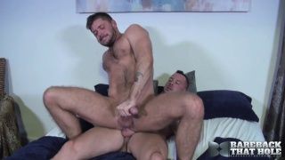 hung guy rides inked stud's big raw cock