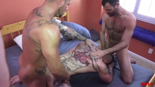 two bearded tops spit-roast fuck a heavily-inked bottom