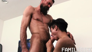 stepfather shows his stepson how to roll on a condom