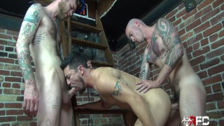 beefy bearded cocksucker takes two dicks
