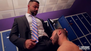 bearded executive gets fucked in his suit in locker room