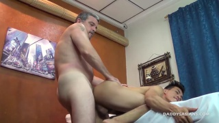 asian boy hugs massage table while daddy fucks his ass
