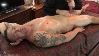 sexy inked hunk gets his dick stroked