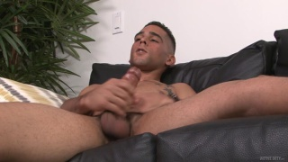 latino guy strokes cum out of his big nuts