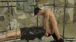 throat fucking a slave boy wrapped in plastic