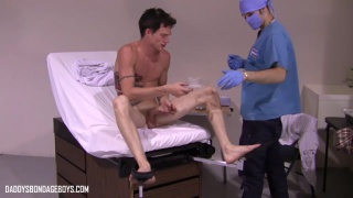 doctor helps his patient give a sperm sample