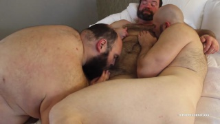 bearded daddy gets serviced by two men