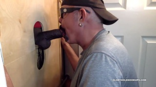 cock-sucking daddy blows an 8-inch black dick at glory hole