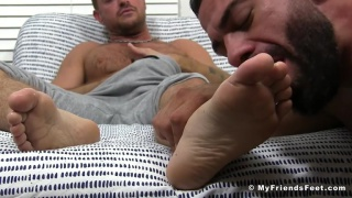 hunk sniffs his buddy's socks and worships his feet