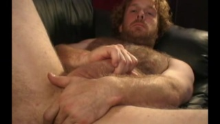 scruffy blond redneck strokes his dick