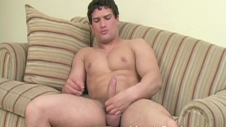Pouty muscle boy strokes uncut cock