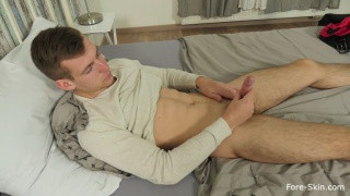 handsome guy tugs and pulls his foreskin