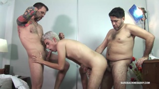 two latin daddies spit-roast fuck a young lad