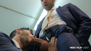 two men in suits sucking and fucking