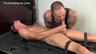 slim guy strapped down and tickled