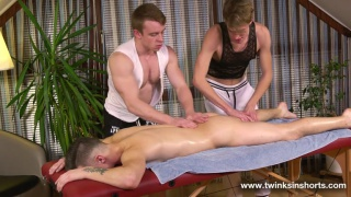 lucky twink gets worked over by two masseurs