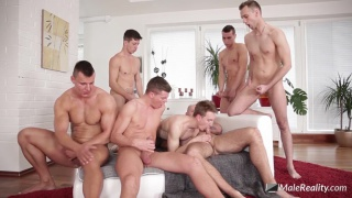 young athlete sucks off a group of guys