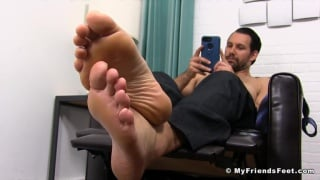 sexy hunk relaxes and puts up his bare feet