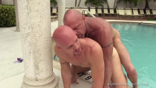bald top fucks his bottom outside by the pool