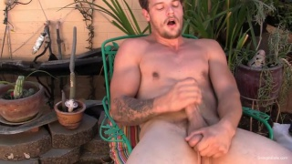 stud holds his big balls while jerking off