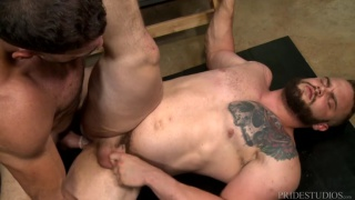 bearded muscle hunk gets screwed on locker room bench