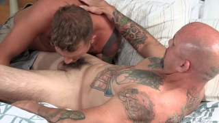 blond lad chokes on bald daddy's cock