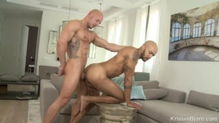 two bald men fucking on a coffee table