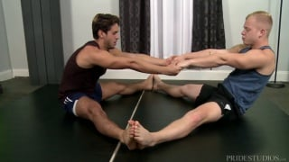yoga instructor puts the moves on client in private session