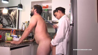 bearded daddy gets fucked over the kitchen counter