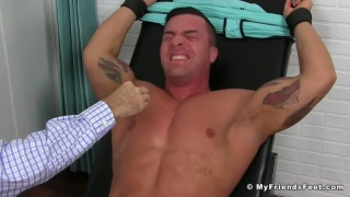 bodybuilder gets his armpits tickled with toothbrush