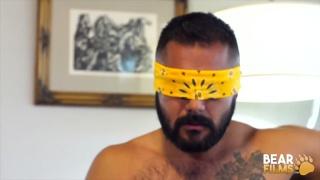 bearded man blindfolds himself for a jack-off session