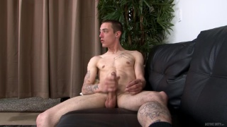 guy works up a creamy load from his big balls