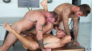 trio of good-looking guys fuck in a threesome