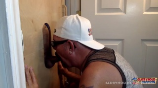 cocksucker in white baseball cap working the glory hole