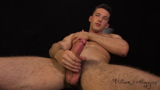 handsome guy pleasures his thick uncut cock