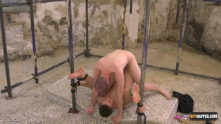 guy chained up in a basement and fucked