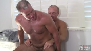 sexy grey-haired daddy sits on a dick backwards